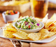 Mexican guacamole with tortilla chips and beer Royalty Free Stock Images