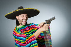 Mexican with gun wearing sombrero Royalty Free Stock Photos