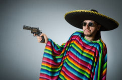 Mexican with gun wearing sombrero Royalty Free Stock Images