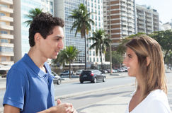 Mexican guy talking with girlfriend in the city Royalty Free Stock Photos
