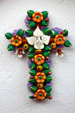 Mexican handcraft floral crux made of clay. A traditional handcraft made in Metepec mexico, a crux made of clay with colorful flowers and leaves Stock Photography
