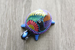 Mexican handcraft turtle over a wood Royalty Free Stock Photos