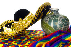 Mexican Hat - Festive. Mexican things including wide brim ornate hat and festive scarves in preparation possibly for cinco de mayo holidy