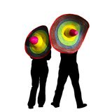 Mexican hats. Couple silhouette with two colorful mexican hats isolated Stock Photography