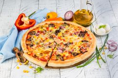 Mexican homemade pizza. Homemade spicy mexican pizza with meat, corn, red onion and pepper. Fast food delivery concept. Copy space stock photos