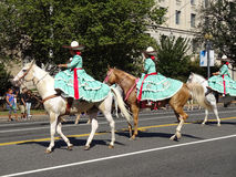 Mexican Horse Women. Photo of mexican women riding horses at the parade at fiesta dc-festival latino on 9/19/15.  Fiesta dc is a latino festival held every year Stock Image