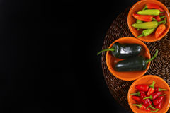 Mexican hot chili peppers colorful mix jalapeno on orange bowls Stock Photo