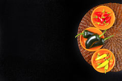 Mexican hot chili peppers colorful mix jalapeno on orange bowls Royalty Free Stock Photography