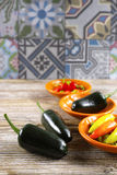Mexican hot chili peppers colorful mix jalapeno on orange bowls Stock Image
