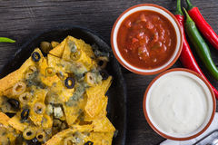 Mexican hot street food nachos with salsa dip Stock Images
