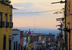 Mexican Houses and Suspended Street Decorations at stock photos