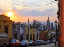 Mexican Houses and Suspended Street Decorations at stock photography