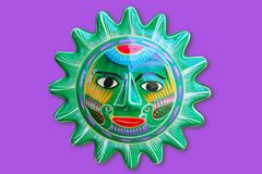 Mexican indian sun handcraft ceramic isolated. In purple background Stock Photography