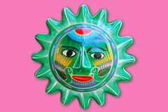 Mexican indian sun handcraft ceramic isolated. In pink background Royalty Free Stock Images
