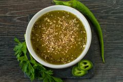 Mexican jalapeno sauce with ingredients. On ruatic table Stock Images