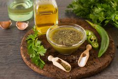 Mexican jalapeno sauce with ingredients. On ruatic table Stock Photos