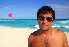 Mexican latin tourist humor suspicios in caribbean. Mexican latin tourist humor suspicios guy in caribbean beach vacation stock photography