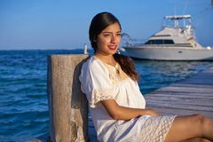 Mexican latin woman in Riviera Maya. Mexican latin woman with ethnic dress in caribbean sea at Riviera Maya stock photography