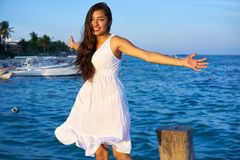 Mexican latin woman in Riviera Maya. Mexican latin woman happy at Caribbean sea of Riviera Maya in Mexico stock photo