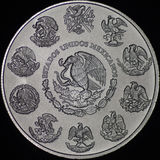 Mexican Libertad Silver Coin (Reverse). These Mexican Libertad coins are made of pure silver and feature the coat of arms of Mexico stock image