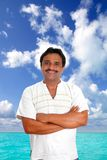 Mexican man with mayan shirt smiling. In tropical beach vacation Stock Photos