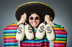 The mexican man with money sacks Stock Image