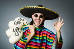 Mexican man with money sacks Royalty Free Stock Photos