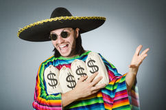 The mexican man with money sacks Stock Photo
