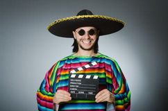 Mexican man with movie board Stock Photos