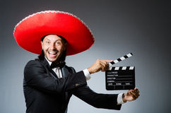 Mexican man. With movie board clapboard stock photography