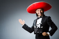 Mexican man with movie Royalty Free Stock Images