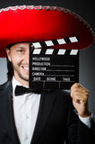 Mexican man with movie Stock Image