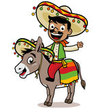 Mexican man riding a donkey Royalty Free Stock Photos