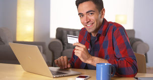 Mexican man smiling with credit card Stock Images