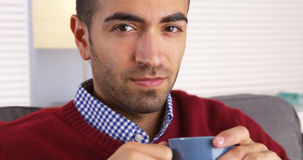 Mexican man smiling with mug Royalty Free Stock Images