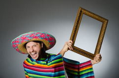 The mexican man with sombrero and picture frame Royalty Free Stock Photos