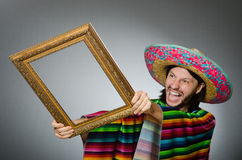 The mexican man with sombrero and picture frame Stock Image