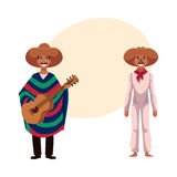 Mexican man in traditional national sombrero and poncho playing guitar Royalty Free Stock Image