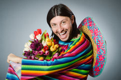 The mexican man with tulip flowers Royalty Free Stock Image
