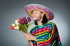 The mexican man with tulip flowers Royalty Free Stock Photos