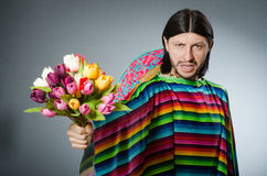 Mexican man with tulip flowers Royalty Free Stock Photography