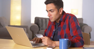 Mexican man using credit card online Royalty Free Stock Photos