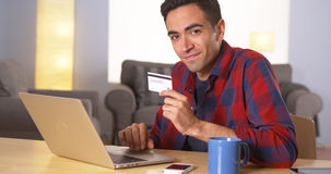 Mexican man using credit card online Royalty Free Stock Photo