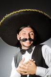 Mexican man wears sombrero isolated on the white Stock Images