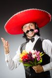 Mexican man wears sombrero isolated on the white Stock Photo