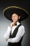 Mexican man wears sombrero isolated on the white. Mexican man wears sombrero isolated on white Royalty Free Stock Images