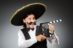 Mexican man wears sombrero isolated on the white Stock Image
