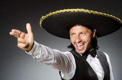 Mexican man wears sombrero isolated on white Stock Photography