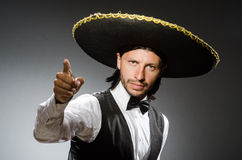 Mexican man wears sombrero isolated on white. The mexican man wears sombrero isolated on white royalty free stock photos