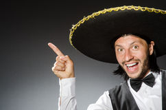 Mexican man wears sombrero  on white Stock Photos